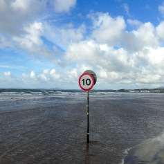 Speed restriction (for walkers in a hurry?) on the beach at Black Rock Sands.