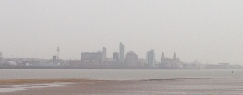 First view of Liverpool, across the Mersey in fog and rain.