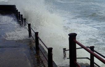 Waves crashing ashore.