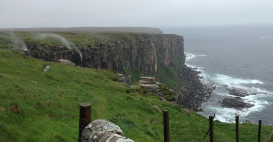 Dunnet Head. Gale force winds blowing waterfalls back up the cliff.