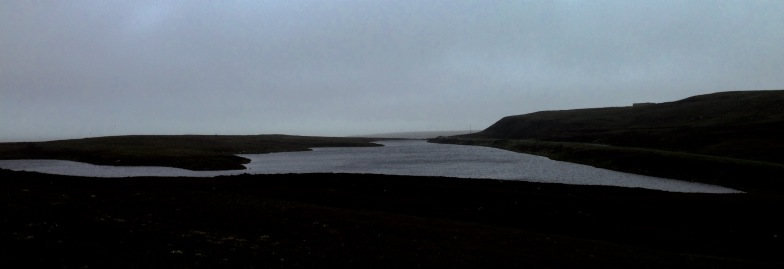 Long Loch in thick fog and driving rain.