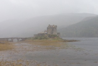 Eilean Donan Castle, in pouring rain; the Isle of Skye behind.