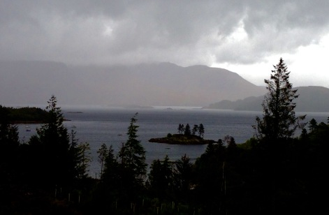 Walking beside Loch Carron in pouring rain.