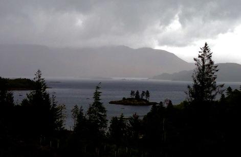 Walking beside Loch Carron in pouring rain.