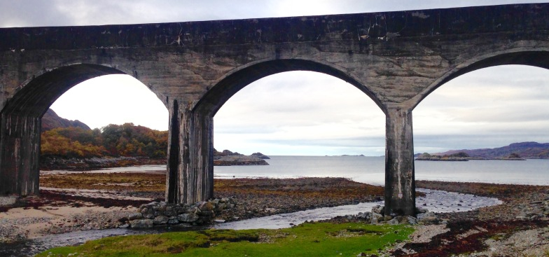 Viaduct on the beach of Loch Nan Uamh. The Prince's Cairn, from where Bonnie Prince Charlie sailed into exile in 1845, is off right.