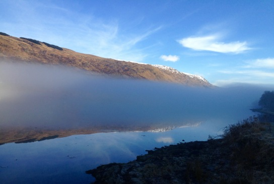 Long horizontal line of mist stretching along Loch Fyne, at Cairndow.